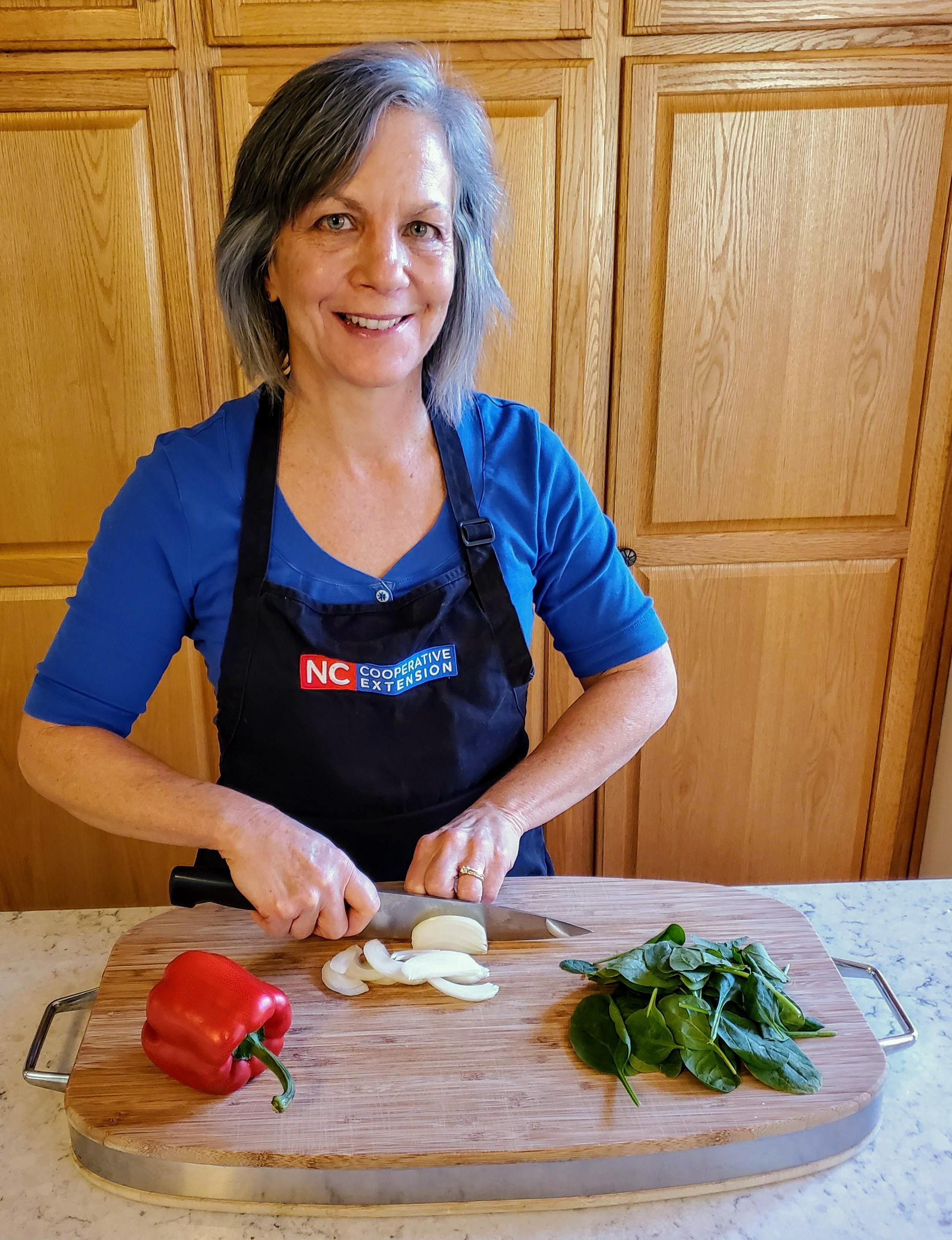 Margie Mansure cuts veggies